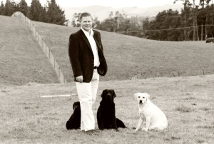 Simon with some of his hunting dogs.